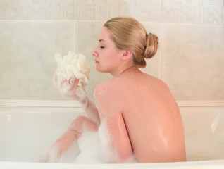 young beautiful girl in a bath