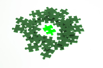 Isolated piece of green lumious jigsaw puzzle