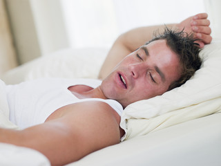 Man lying in bed sleeping
