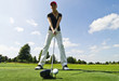 Golfspielerin beim Abschlag