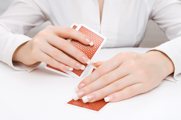 Woman peeping in under playing card