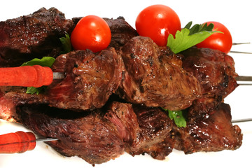 grilled meat on skewer with tomatoes