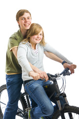 Young couple on a bicycle isolated on a white