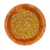Pollen grains in wooden dish poster