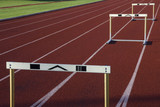 running tracks with three hurdles poster