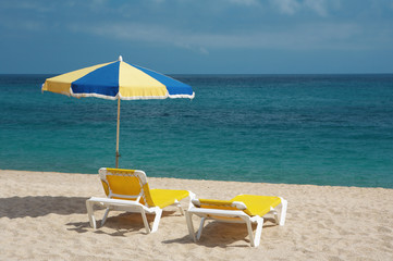 two chairs and beach umbrella