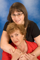 Portrait of attractive senior woman with her daughter