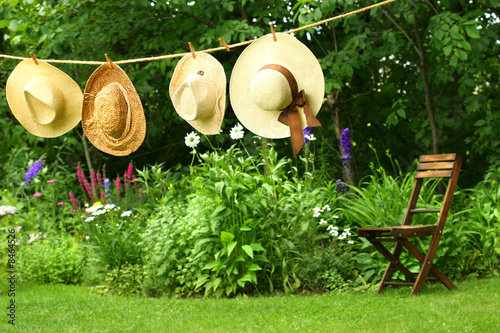 Summer straw hats hanging clothesline
