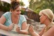 Leinwanddruck Bild - Girlfriends Enjoy A Conversation
