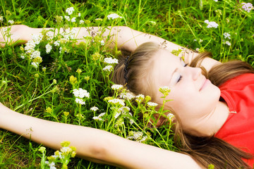 Young woman resting in grass