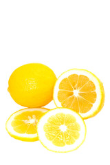 Whole and Sliced Bright Yellow Meyer Lemons On White Background
