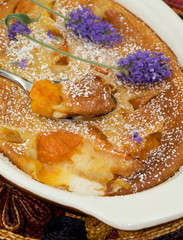 close up of freshly baked peach clafouti pei