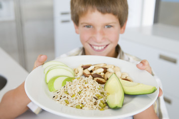 Boy holding plate of food
