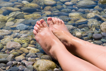 woman feet relax in the beach