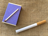 matches and single cigarette at linen poster