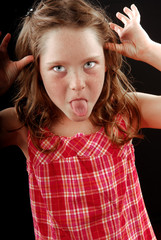 young girl making face
