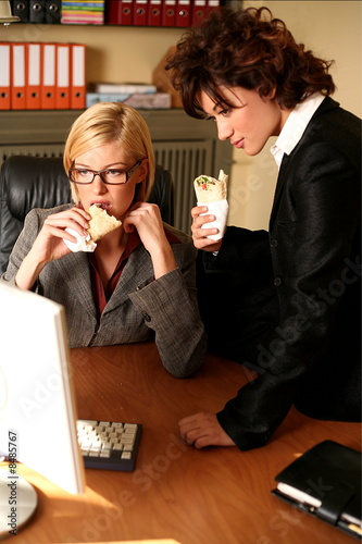 Two women working at the computer
