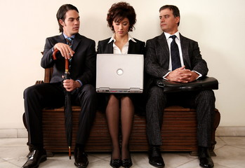 Three people sitting in a waiting room