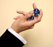 A woman holding a pair of blue dice