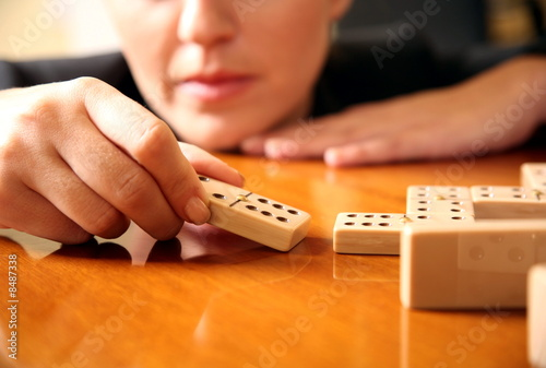 A woman playing with dominoes