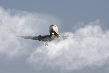 Airliner through the clouds