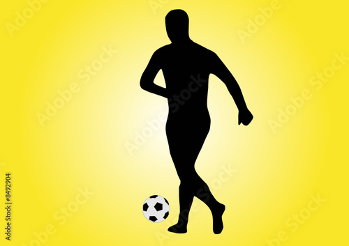 soccer player running with ball