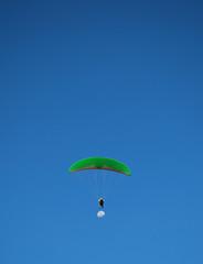 Paragliding over the moon in Niteroi, Rio de Janeiro, Brazil