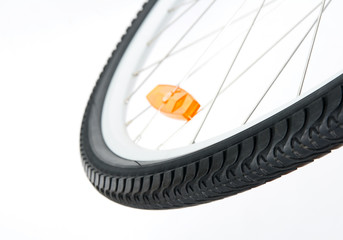 Bicycle wheel with orange reflector