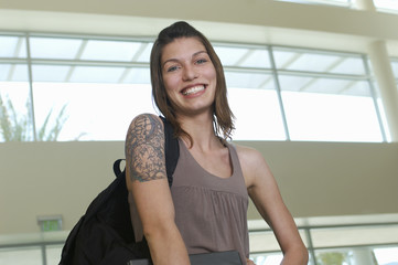Female student smiling, indoors, portrait