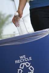Person recycling plastic bottle, close-up