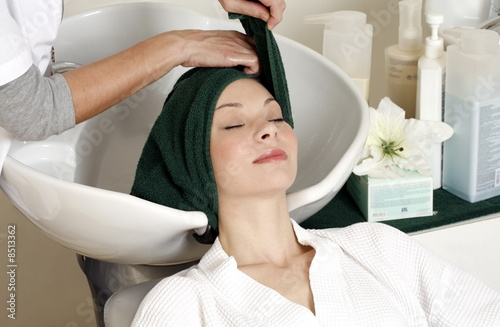 Young woman  having her hair  washed at a salon