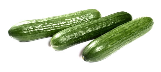 Fresh cucumbers on white