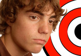 teenage boy with target behind his head - concept of bullying poster
