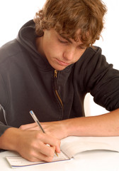 teenage boy writing check or doing financial accounting