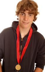 attractive teenage boy wearing winning medal on his neck