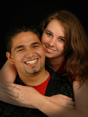 beautiful young engaged spanish caucasian mixed couple