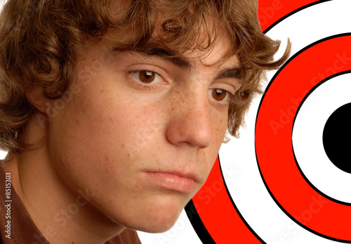 teenage boy with target behind his head - concept of bullying