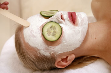 Woman having a facial treatment in a spa