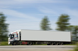A heavy truck hurries to deliver a load on purpose. poster
