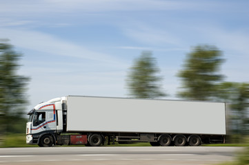 A heavy truck hurries to deliver a load on purpose.