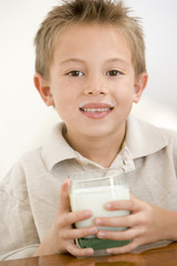 Young boy drinking milk smiling