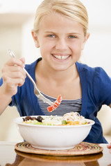 Young girl eating seafood smiling