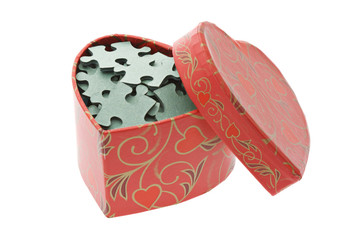 Jigsaw puzzles in heart shape gift box