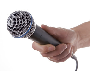 Womans hand holding microphone