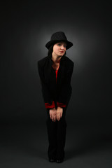 pretty teen in black pantsuit and tophat