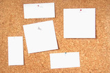 Five blank cards on a cork board