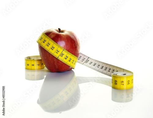 Manzana con cinta metrica,concepto dieta sana