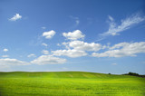 Landscape wit green field and clouds