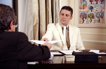 Two businessmen working in a hotel room