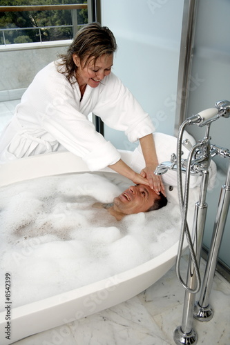 Mature couple having fun in the bathtub